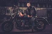 image of carburetor  - Biker and his bobber style motorcycle on a city streets  - JPG