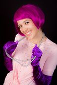 stock photo of wig  - Woman dressed in shiny outfit and purple wig - JPG