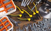 image of triplets  - Set of different tools on wooden background - JPG