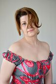 picture of bare-naked  - Portrait of a woman in a dress with bare shoulders - JPG