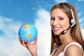 picture of receptionist  - receptionist with headphones and globe on sky background - JPG