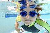 pic of swimming  - Child kid diving and swimming in pool underwater summer or sports theme