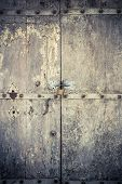 foto of entryway  - aged dark vintage wooden door as background with cuttings and scratch  - JPG