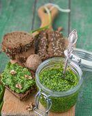 foto of pesto sauce  - Ramson wild garlic and sauce pesto on a wooden table - JPG