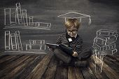 picture of child development  - Child Little Boy in Glasses Reading Book over School Black Board with Chalk Drawing Kids Preschool Development Children Education Concept - JPG