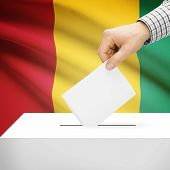 pic of guinea  - Ballot box with national flag on background series  - JPG