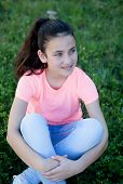 picture of  preteen girls  - Beautiful preteen girl with blue eyes sitting on the grass - JPG