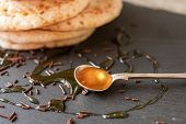 image of maple syrup  - pancakes with honey and maple syrup with chocolate sprinkles - JPG