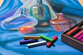 image of pastel  - Artists chalk pastels and original pastel drawing of still life on the background - JPG