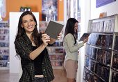 Happy Women At The Video Rental Store