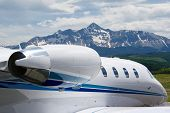 stock photo of cessna  - a cessna citation business jet parked in front of a mountain backdrop in telluride colorado - JPG