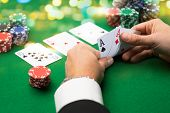 Постер, плакат: casino gambling poker people and entertainment concept close up of poker player with playing ca