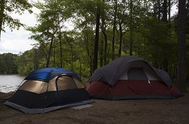 pic of nylons  - Two nylon tents in a campsite next to a lake - JPG