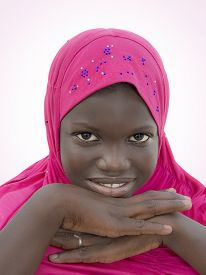 picture of ten years old  - Smiling girl wearing a pink headscarf - JPG