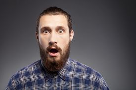 pic of shock awe  - Attractive bearded guy is standing in blue shirt - JPG