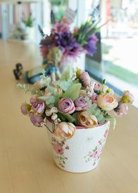 picture of decoupage  - flowers vase decoupage decorated on wooden table at living room artificial flowers in vase - JPG
