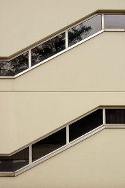 image of superimpose  - Two superimposed corridors with zig zag windows - JPG
