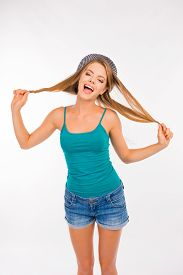stock photo of fool  - funny girl fooling around with her hair - JPG