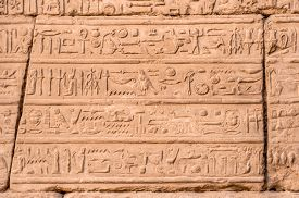 picture of hieroglyphic  - Hieroglyphics on the wall near hypostyle hall of an ancient Karnak Temple in Luxor - JPG