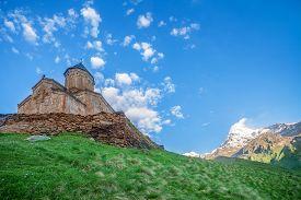 stock photo of trinity  - Holy Trinity Church near Mount Kazbek in Georgia - JPG
