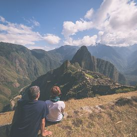 picture of marsala  - Two people sitting in contemplation on the terraces above Machu Picchu the most visited travel destination in Peru - JPG
