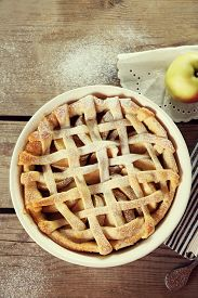 picture of shoulder-blade  - Homemade apple pie on wooden background - JPG