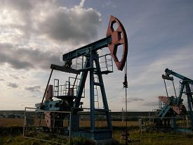 image of raw materials  - Long line of oil pumping units on a large - JPG
