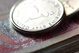 stock photo of dirham  - An extreme close up and details of One UAE dirham coin - JPG
