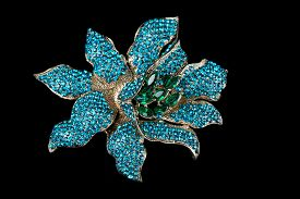 image of brooch  - Colorful gem brooch brooch in the form of a flower on black background - JPG