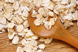 image of oats  - Rolled oats and oat ears of grain on a wooden table close - JPG