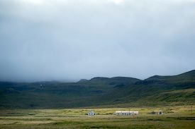 picture of iceland farm  - Distant view of farms and mountains in Iceland in summer - JPG