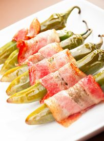 picture of jalapeno  - Grilled jalapenos wrapped in bacon isolated on white - JPG