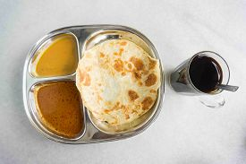 picture of malaysian food  - Famous Malaysian breakfast set an Indian Food called Roti Parata or Roti canai with black coffee - JPG