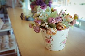 stock photo of decoupage  - flowers vase decoupage decorated on wooden table at living room artificial flowers in vase - JPG