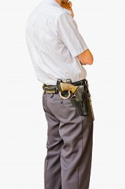 picture of shackles  - Security guard standing and armed with shackles a gun and bullets isolated over white - JPG