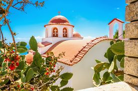 image of greek-island  - Cozy view on typical Greek church with red roofing - JPG
