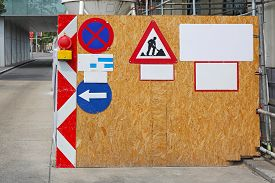stock photo of safety barrier  - Construction Site Barrier Fence With Safety Signs - JPG