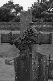 stock photo of celtic  - detail of a celtic grave with a sculpured rose Ireland - JPG