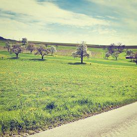 stock photo of farmhouse  - Asphalt Road Leading to the Farmhouse in the Swiss Alps Instagram Effect - JPG