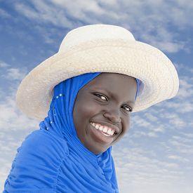 image of ten years old  - Muslim girl wearing a straw hat - JPG