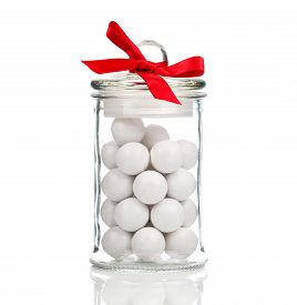 stock photo of gumballs  - white candies Gumballs in glass jar over white background - JPG