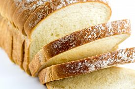 picture of fresh slice bread  - Macro closeup of freshly baked slices of white bread - JPG