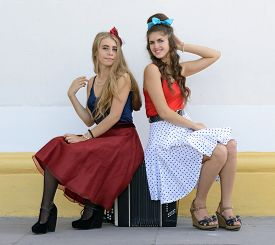 picture of accordion  - two girls sitting on old accordion - JPG