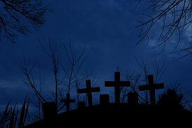 stock photo of moonlight  - Silhouette of graveyard in the dark of halloween night with full moonlight - JPG