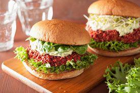 image of veggie burger  - veggie beet and quinoa burger with avocado dressing - JPG