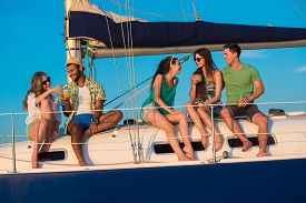 picture of yacht  - Young people is resting on the sailing yacht - JPG