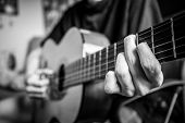 Musician Playing Acoustic Guitar, Black And White Photo poster