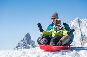 Father and son sledding during winter holiday. Happy dad and little boy playing with snow sled. Man  poster