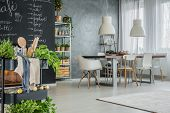 Kitchen With Industrial Dining Area poster