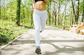 Jogging And Running Woman With Athletic Legs On Jog Or Run In Healthy Lifestyle Concept With Close U poster